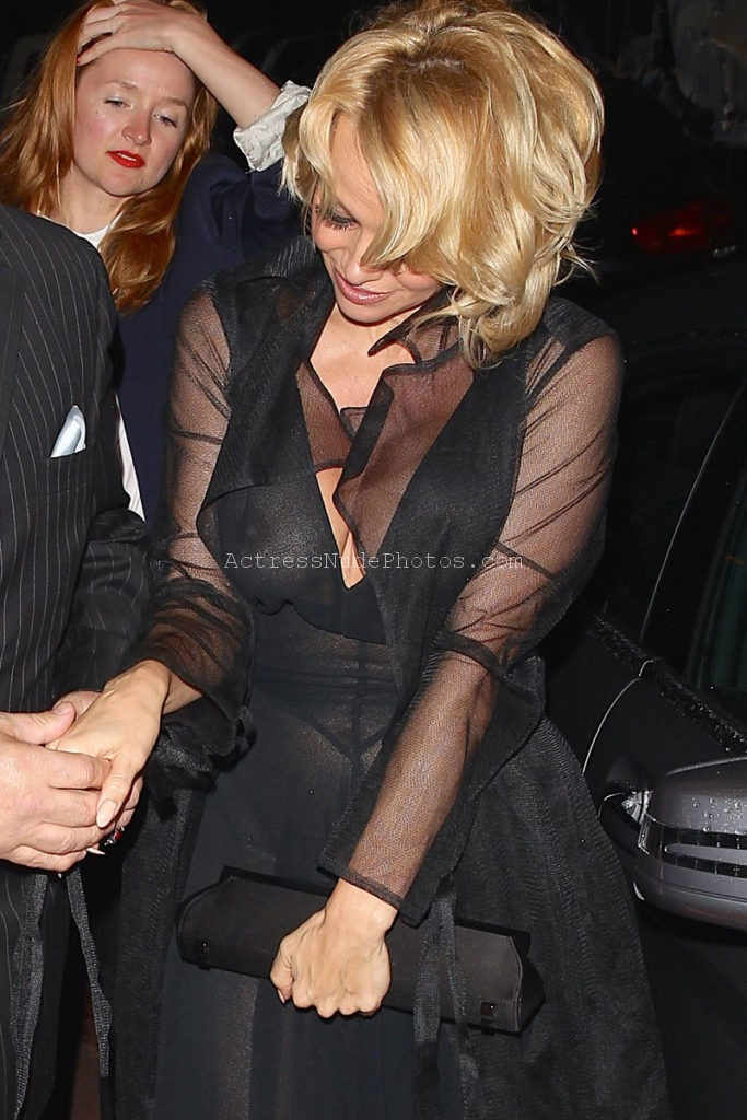 Pamela Anderson wearing a see through