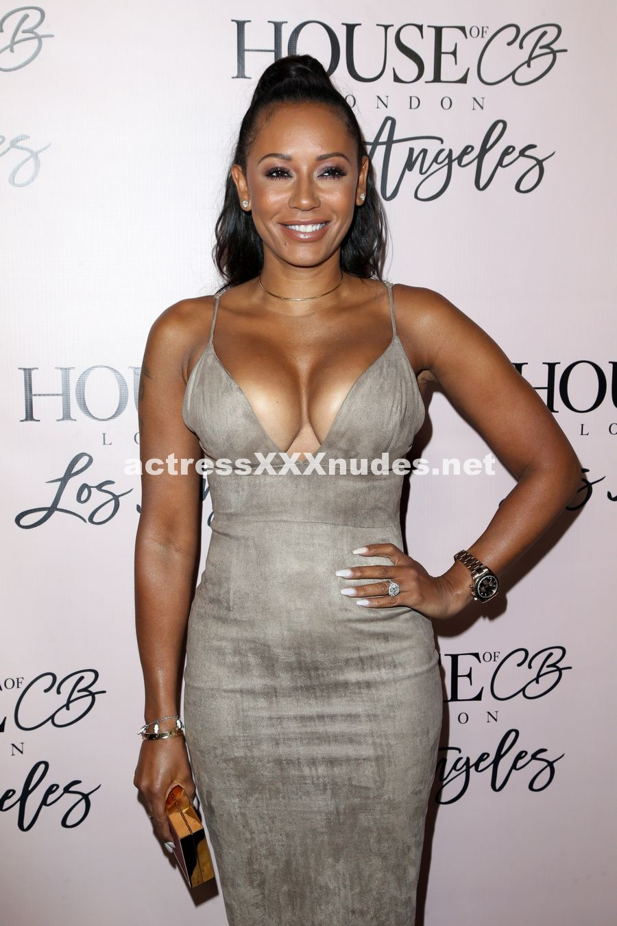 Melanie Brown looked very busty in a dress showing off those big titties