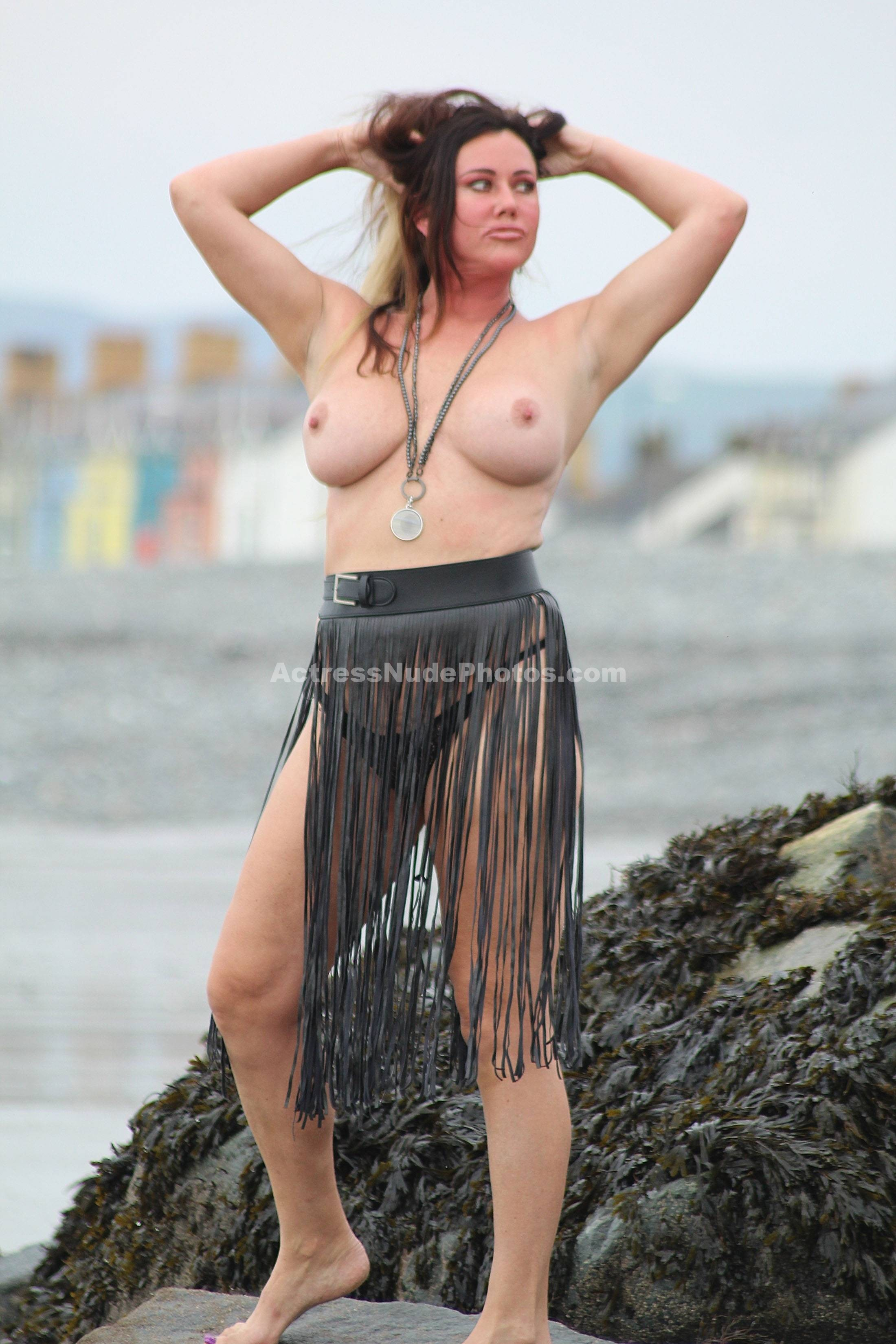 Lisa Appleton posing topless